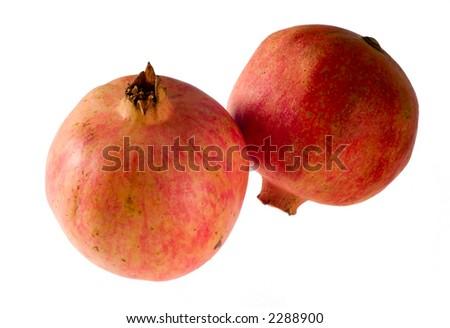 Two pomegranates isolated on white background - stock photo