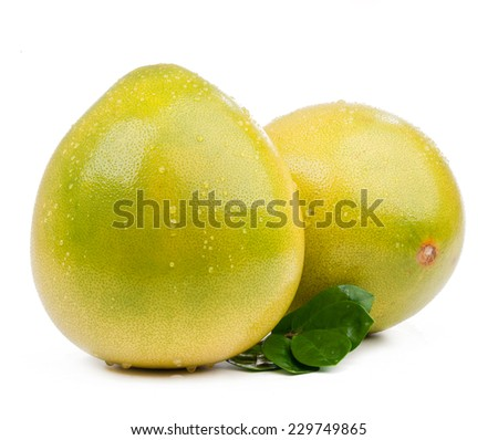 two pomelo with leaves isolated on white background - stock photo