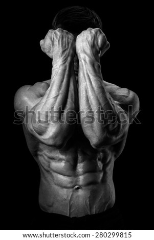 Two Power Hands in Front of Face. Close-up of a man's fists and abs. Strong man's arm with muscles and veins. Black and white photo - stock photo