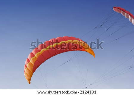 two power kites on the sky - nearly a collision