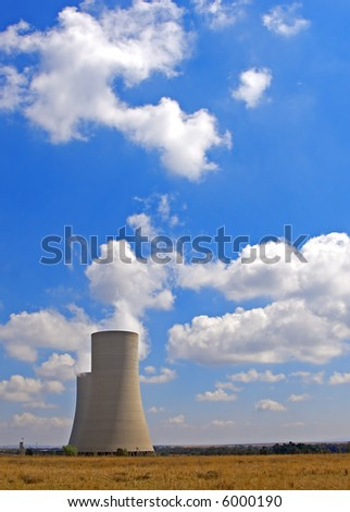 Two power station cooling tower in a vast open landscape