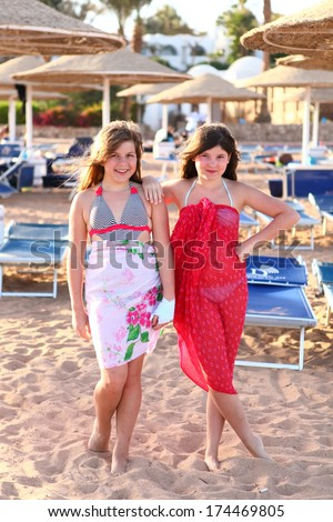 two preteen girls on the summer beach