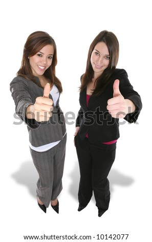 Two pretty business women with their thumbs up - stock photo