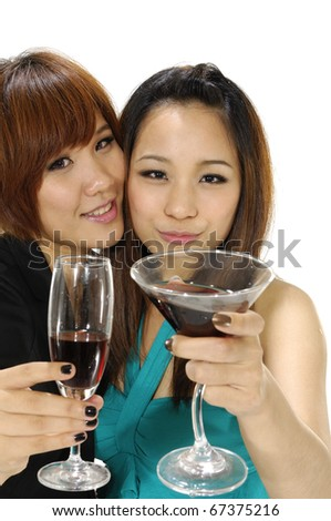 Two pretty cheerful women with glasses of wine, - stock photo