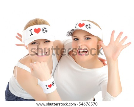 Two pretty football fan girls in funny hats. isolated on white background - stock photo