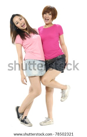 Two pretty girl friends having fun and laughing. - stock photo