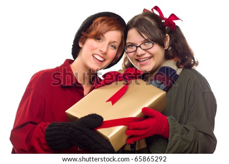 Two Pretty Girlfriends Holding A Holiday Gift Isolated on a White Background.