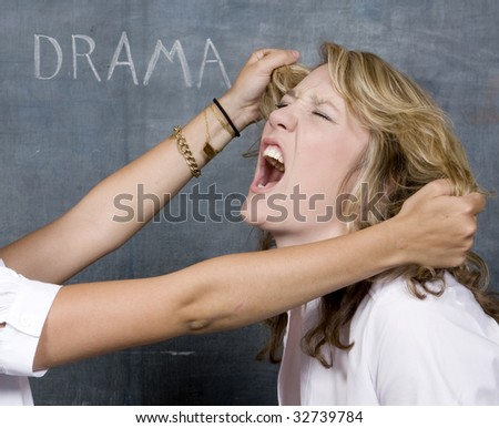 Two Pretty girls Abuse each other in front of a chalkboard