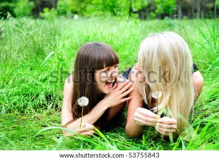 two pretty girls having fun outdoor - stock photo
