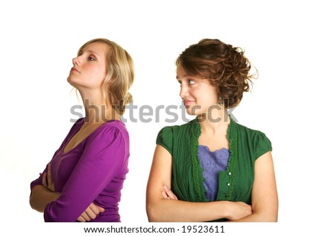 Two pretty girls in an argument - stock photo