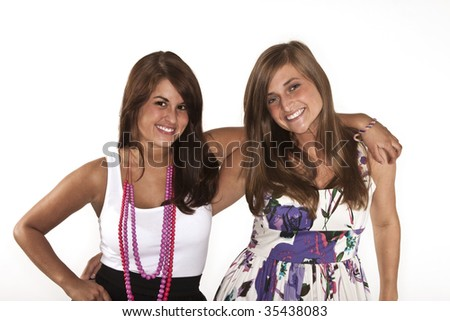 two pretty girls smiling and hugging - stock photo