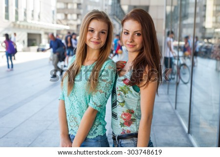 Two pretty girls. They are best friends. Outdoor photo - stock photo