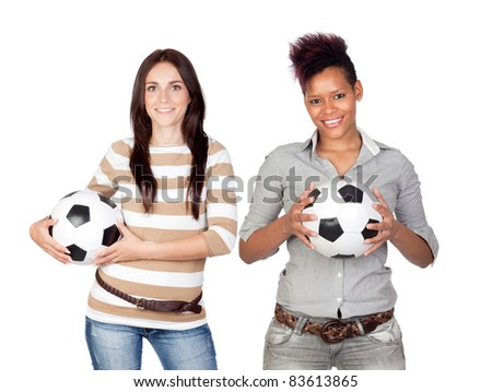 Two pretty girls with a soccer ball isolated on white background - stock photo