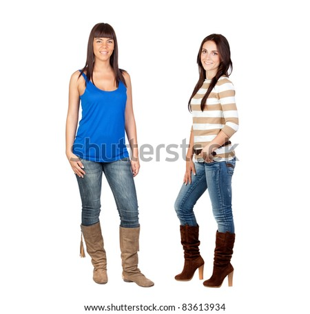 Two pretty girls with jeans isolated on a over white background - stock photo