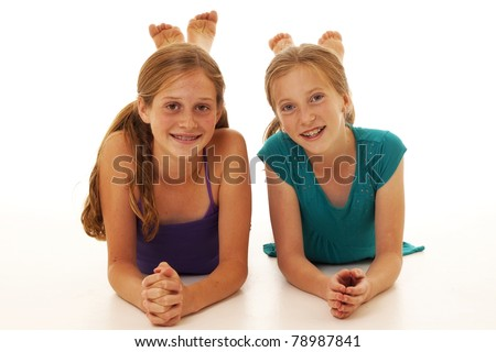 two pretty little girls posing for a picture - stock photo
