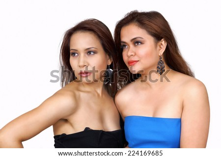 Two pretty multiethnic women looking to side with interest