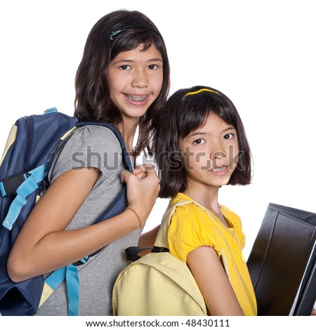 Two pretty sisters wit folders, files and bags ready for school - stock photo