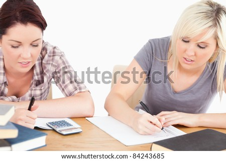 Two pretty students doing homework
