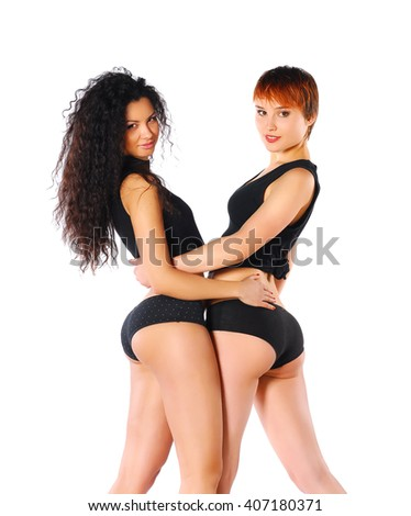Two pretty woman in black lingerie on white background. Lesbian couple. - stock photo