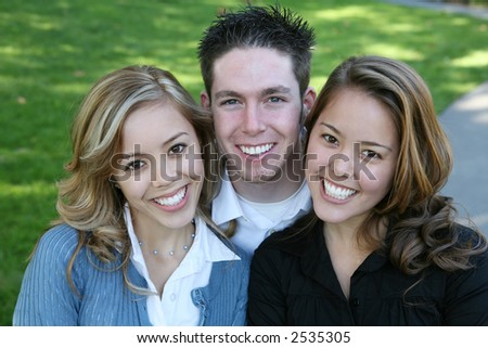 Two pretty women and guy together as friends - stock photo