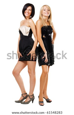 Two pretty women in black gowns, isolated on white - stock photo