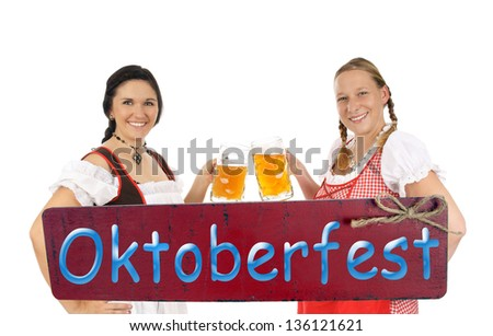 two pretty women with beer mug and plate - Oktoberfest / munich beer festival - stock photo
