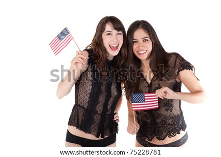 Two pretty young ladies, in lingerie, facing the camera and holding small American flags