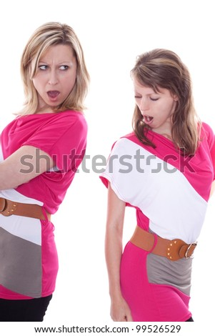 two pretty young woman compete for a dress - stock photo