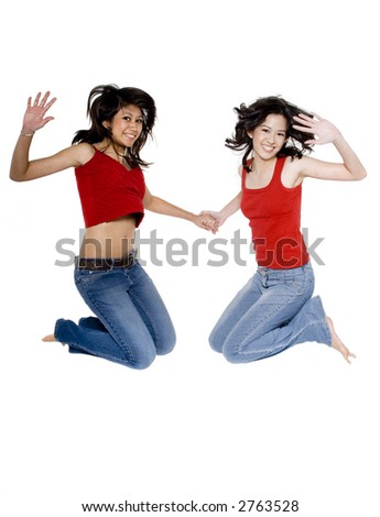 Two pretty young women jumping in the air on white background