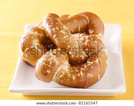 two pretzels on a plate - stock photo