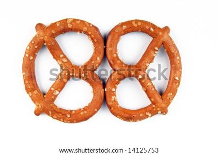 Two pretzels on a white background - stock photo