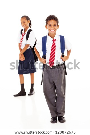 two primary school students standing on white - stock photo
