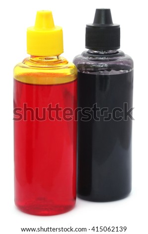 Two printer ink bottles over white background - stock photo