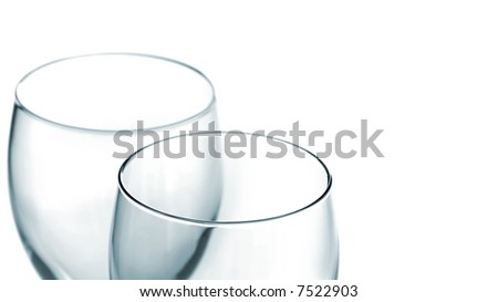 Two Pristine Empty Wine Glasses with Loads of Copy Space Isolated on White - stock photo