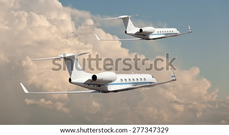 Two private jets flying side by side  - stock photo