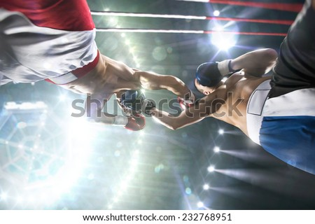 Two professional boxers are fighting on the grand arena - stock photo