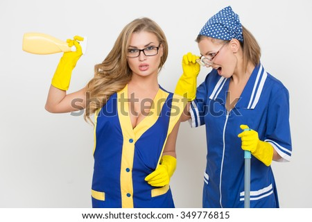 two professional cleaners. sexy busty girl and ugly. - stock photo
