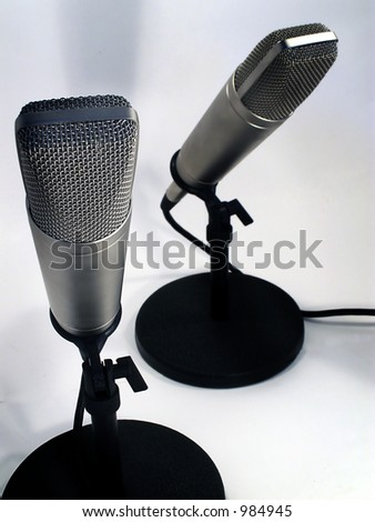 Two professional studio microphones. - stock photo