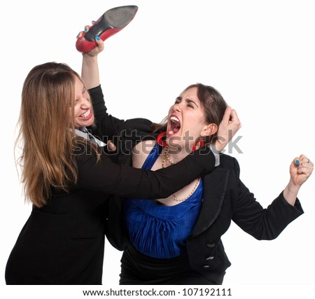 Two professional woman fighting over white background - stock photo