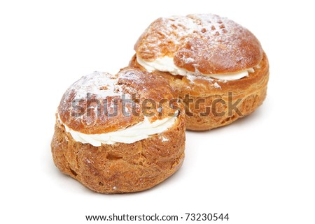 Two profiteroles isolated on white background