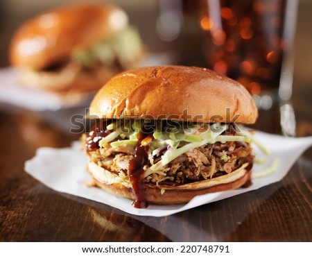 two pulled pork bbq sandwiches with cole slaw - stock photo