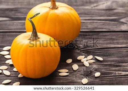 Two pumpkin on wooden board black color.