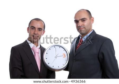 Two punctual business men holding clock