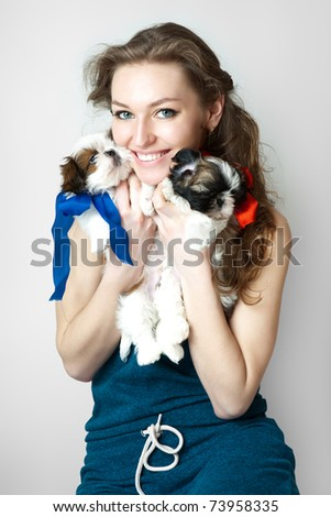Two puppies and female model. - stock photo