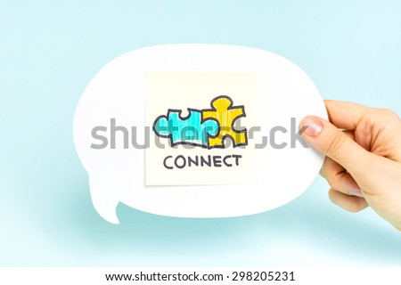Two puzzle pieces with the word connect, on speech bubble and blue background. Business concept. - stock photo