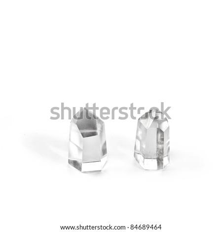 Two quartz crystals on white background. - stock photo