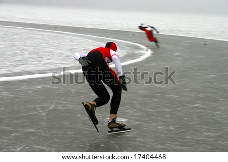 Two racing skaters on the competition - stock photo
