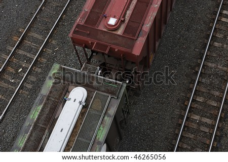 Two Railroad freight cars - view from high vantage point looking down on two coupled cars with slight movement - stock photo