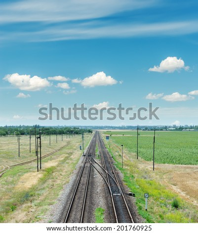 two railroad to horizon and blue sky - stock photo