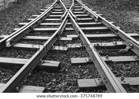 Two railway tracks merge - stock photo
